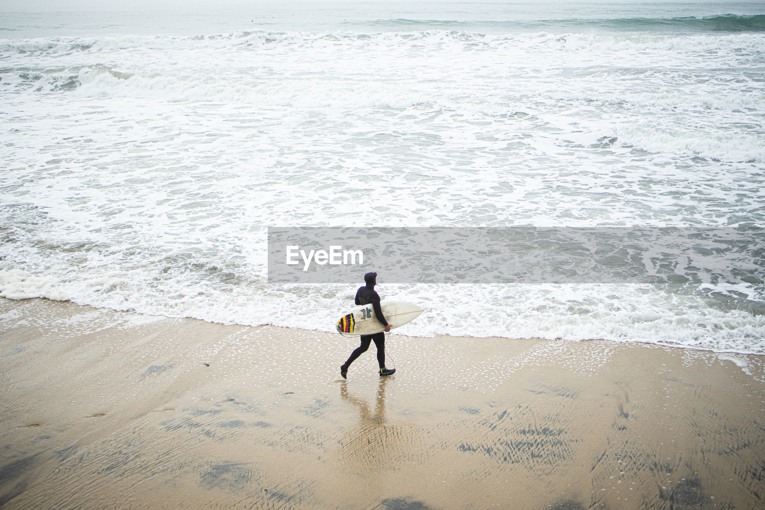 REAR VIEW OF PERSON ON BEACH