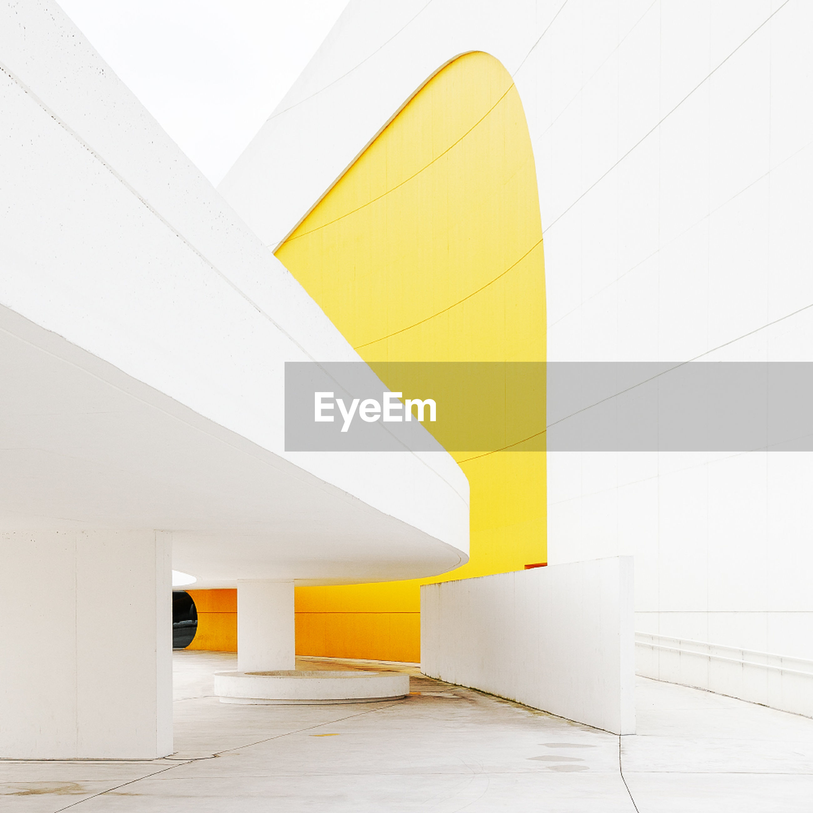 built structure, architecture, white color, yellow, no people, building, wall - building feature, building exterior, modern, day, outdoors, wall, flooring, architectural column, sunlight, orange color, empty, nature, city, ceiling, blank