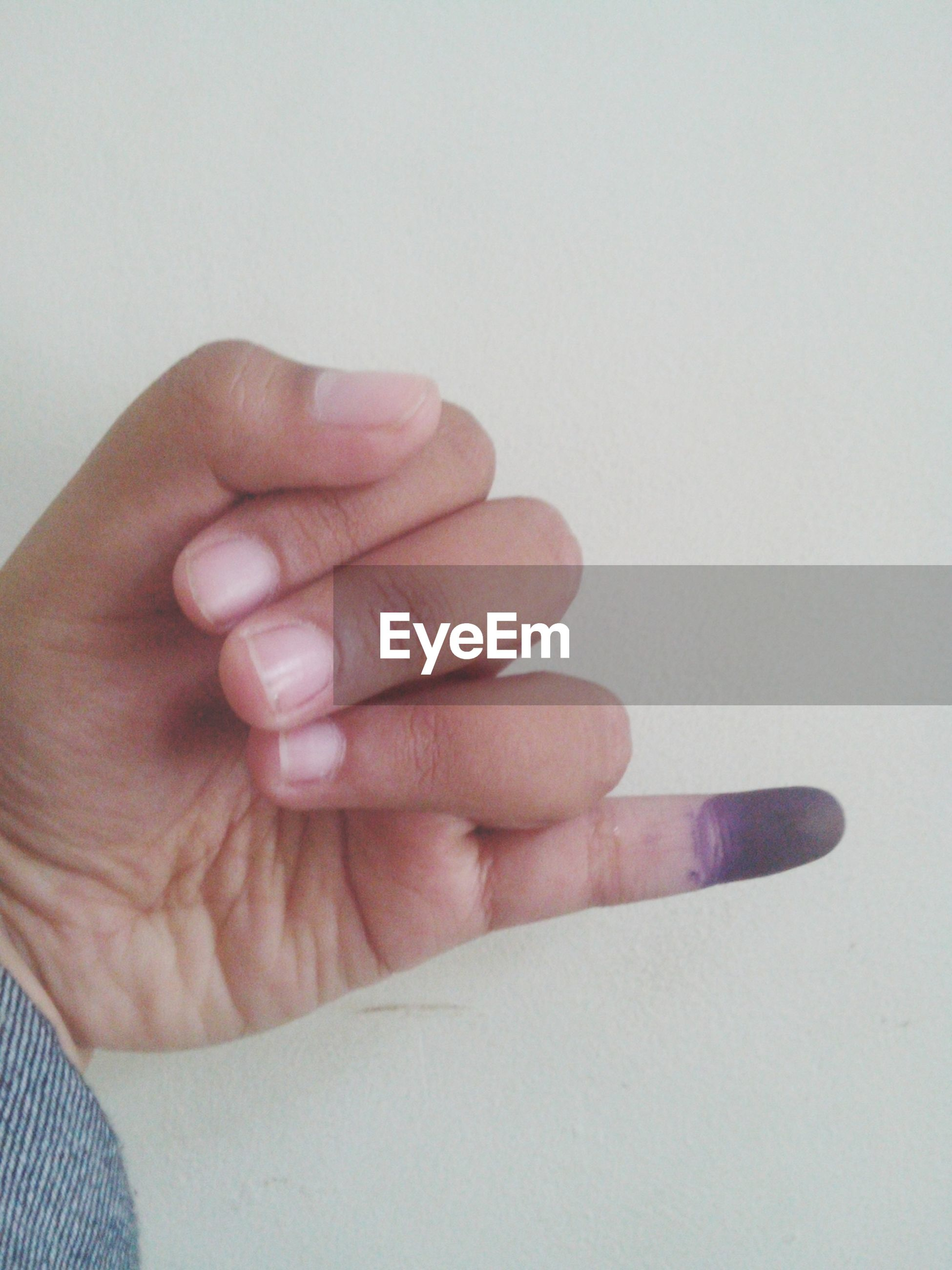person, part of, human finger, cropped, studio shot, white background, holding, close-up, indoors, copy space, personal perspective, unrecognizable person, lifestyles, showing, palm, human skin