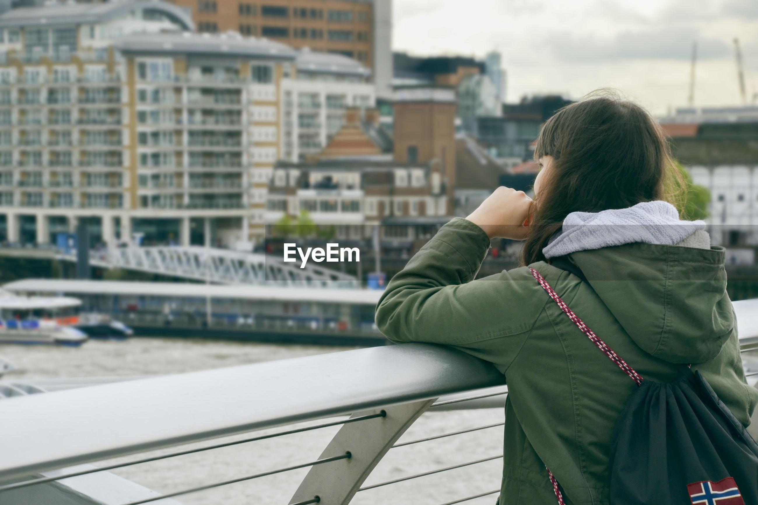 Woman looking at city view