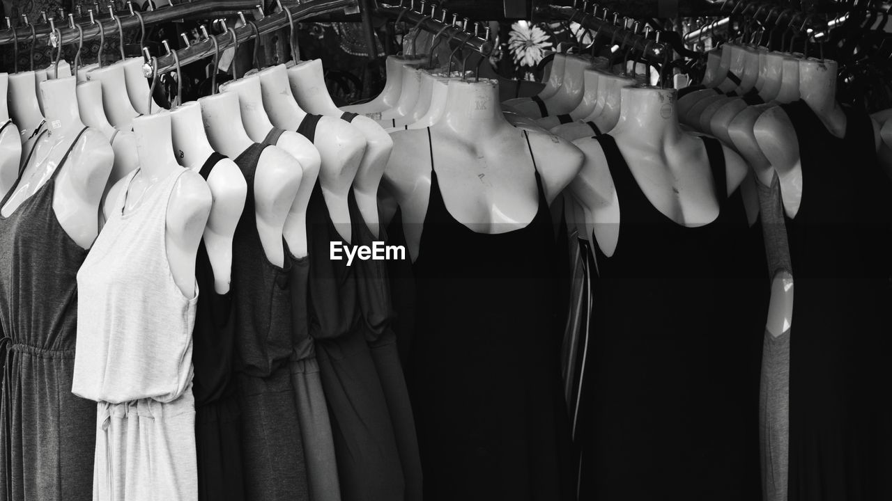 ROW OF CLOTHES HANGING ON RACK