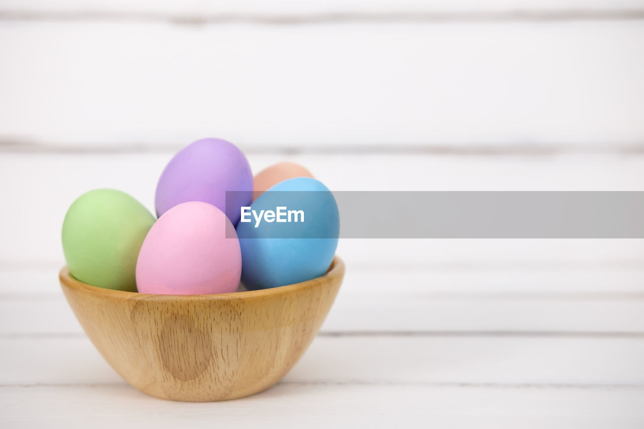 Close-up of colorful easter eggs in bowl on table