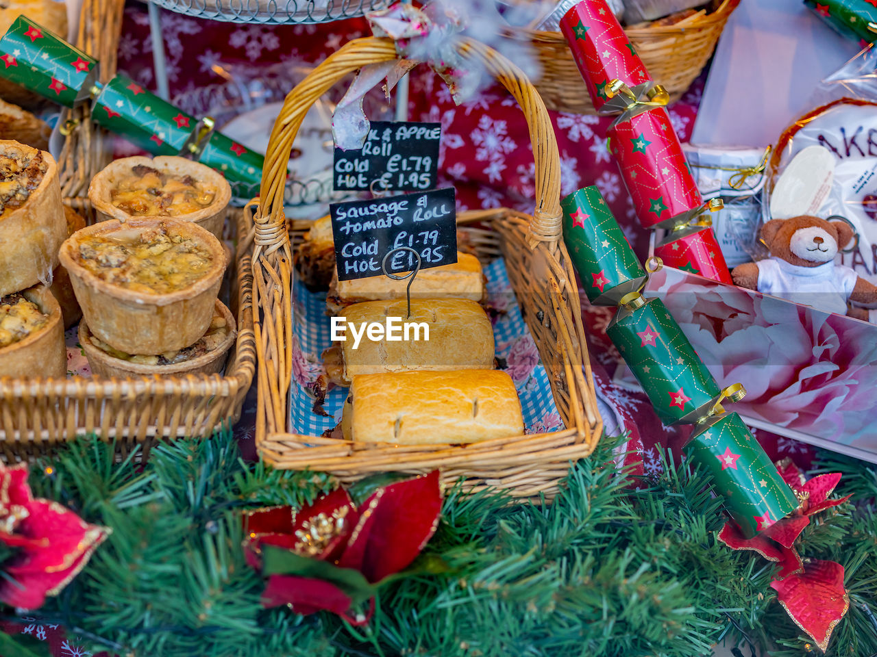 Baked christmas special pies, pastries and foods on display and for sale in the window of a bakery