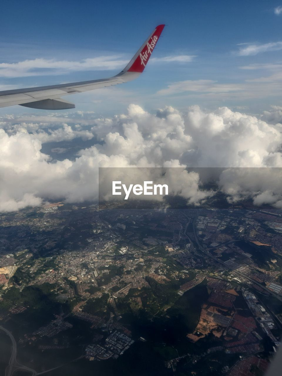 cloud - sky, sky, nature, mountain, environment, flying, day, scenics - nature, aerial view, beauty in nature, airplane, air vehicle, landscape, no people, mid-air, tranquil scene, outdoors, tranquility, transportation, non-urban scene