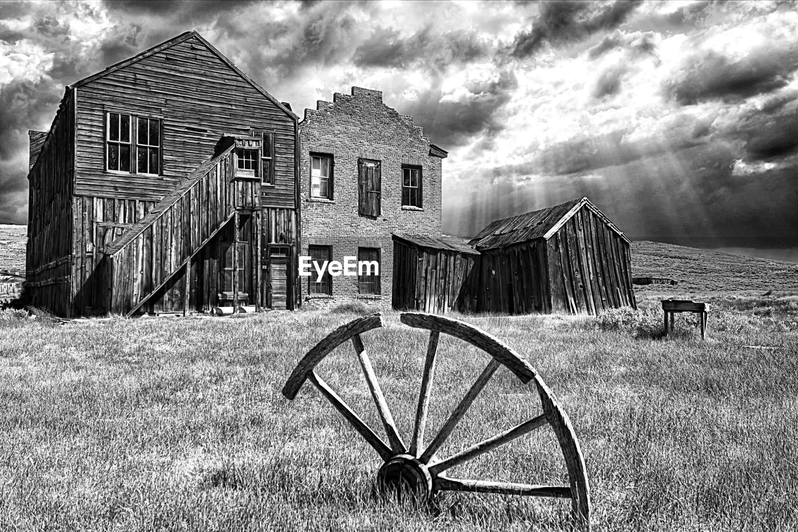 sky, cloud - sky, cloudy, building exterior, built structure, architecture, cloud, field, grass, house, transportation, land vehicle, abandoned, weather, bicycle, mode of transport, stationary, outdoors, landscape, no people