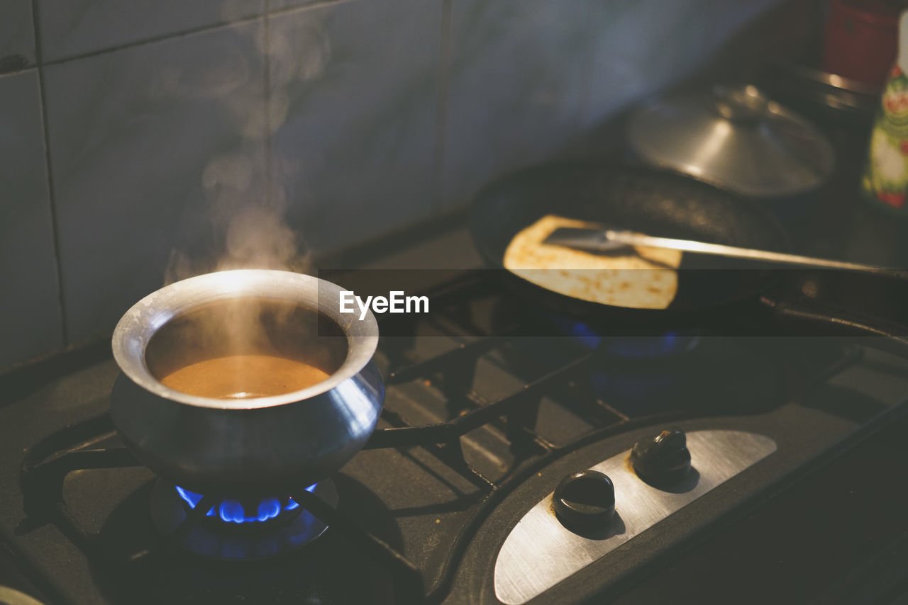 Food Cooking On Stove At Kitchen
