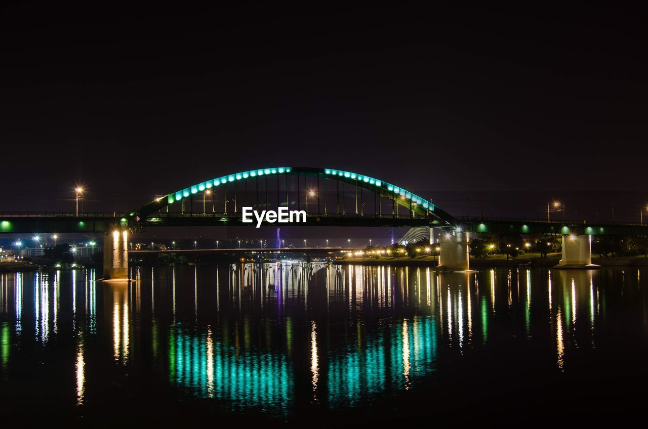 night, water, illuminated, reflection, architecture, bridge, connection, built structure, bridge - man made structure, no people, sky, nature, city, waterfront, lighting equipment, building exterior, transportation, river, copy space, outdoors