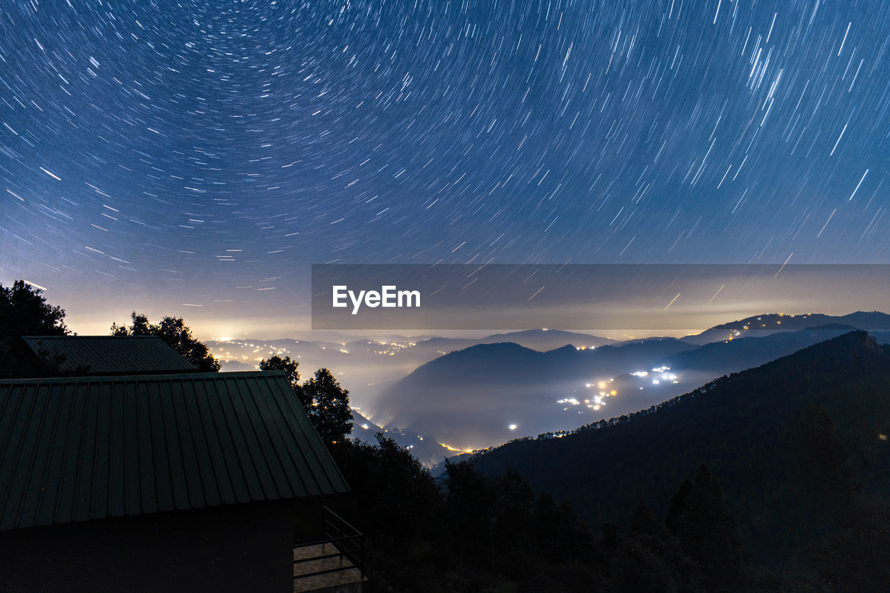 architecture, sky, mountain, built structure, nature, building exterior, star - space, no people, beauty in nature, scenics - nature, night, tree, astronomy, space, star trail, building, silhouette, long exposure, tranquility, cloud - sky