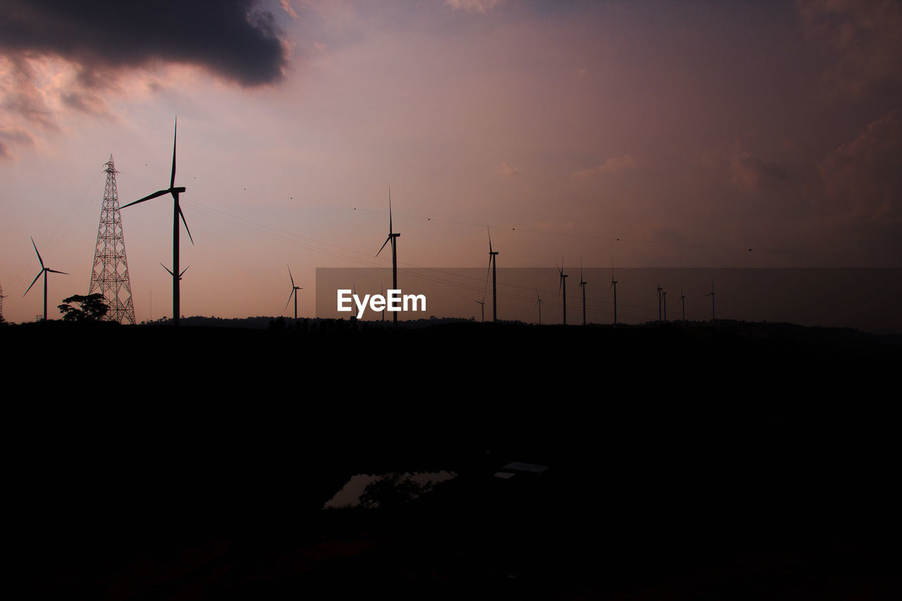 environment, wind turbine, fuel and power generation, sky, turbine, environmental conservation, wind power, renewable energy, alternative energy, technology, landscape, sunset, silhouette, nature, land, beauty in nature, cloud - sky, field, scenics - nature, orange color, no people, outdoors, electricity, power supply, sustainable resources, electrical equipment