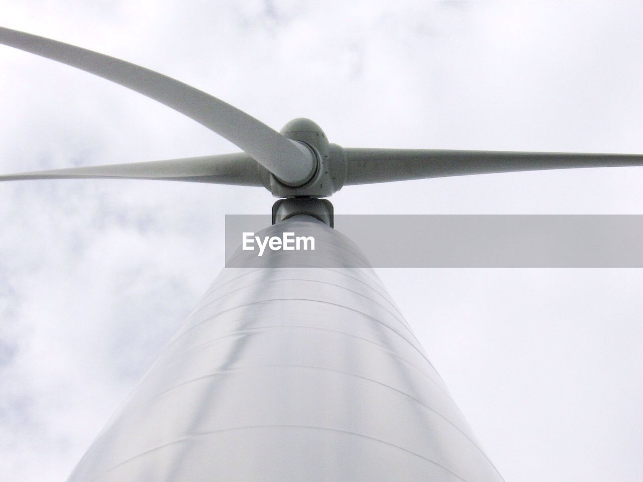 low angle view, sky, no people, day, metal, nature, outdoors, close-up, pole, fuel and power generation, cloud - sky, tall - high, architecture, built structure, hanging, environment, turbine, security, renewable energy, textile, directly below, steel