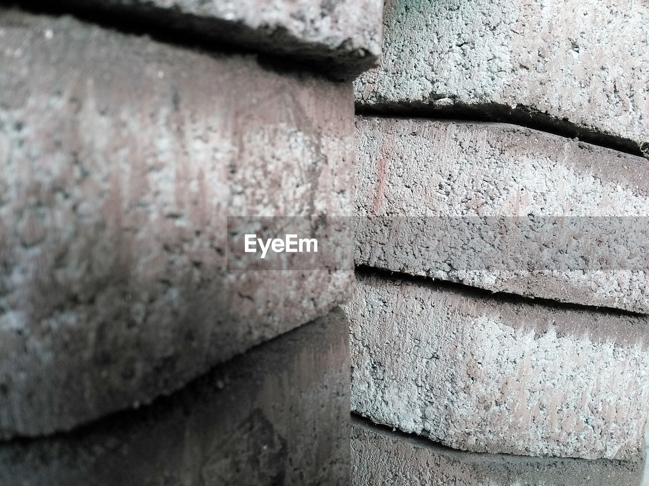 wall - building feature, close-up, architecture, no people, built structure, solid, wall, day, textured, focus on foreground, concrete, gray, stone material, old, selective focus, backgrounds, rough, pattern, outdoors, full frame, cement