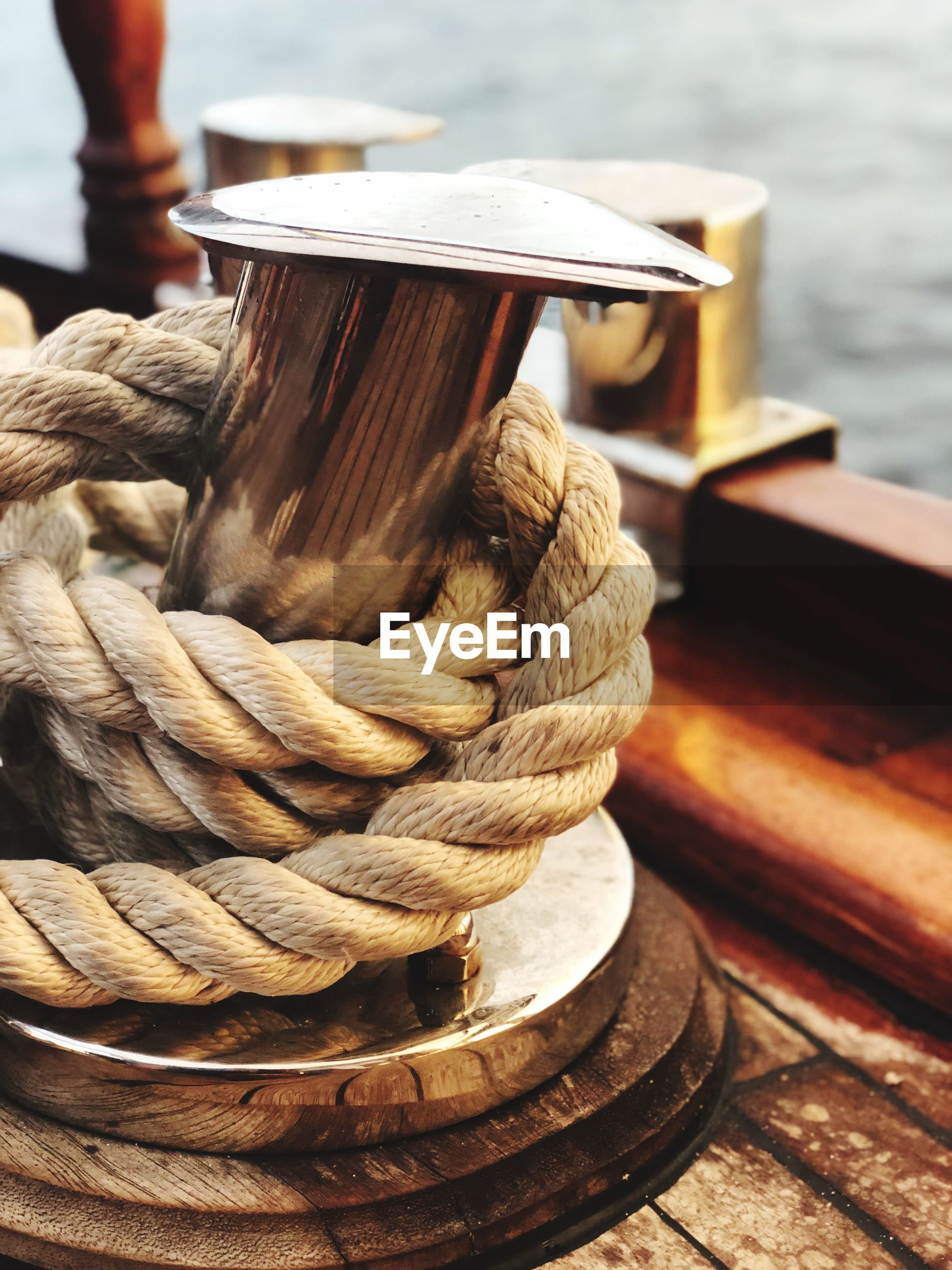 Close-up of rope tied on cleat in ship