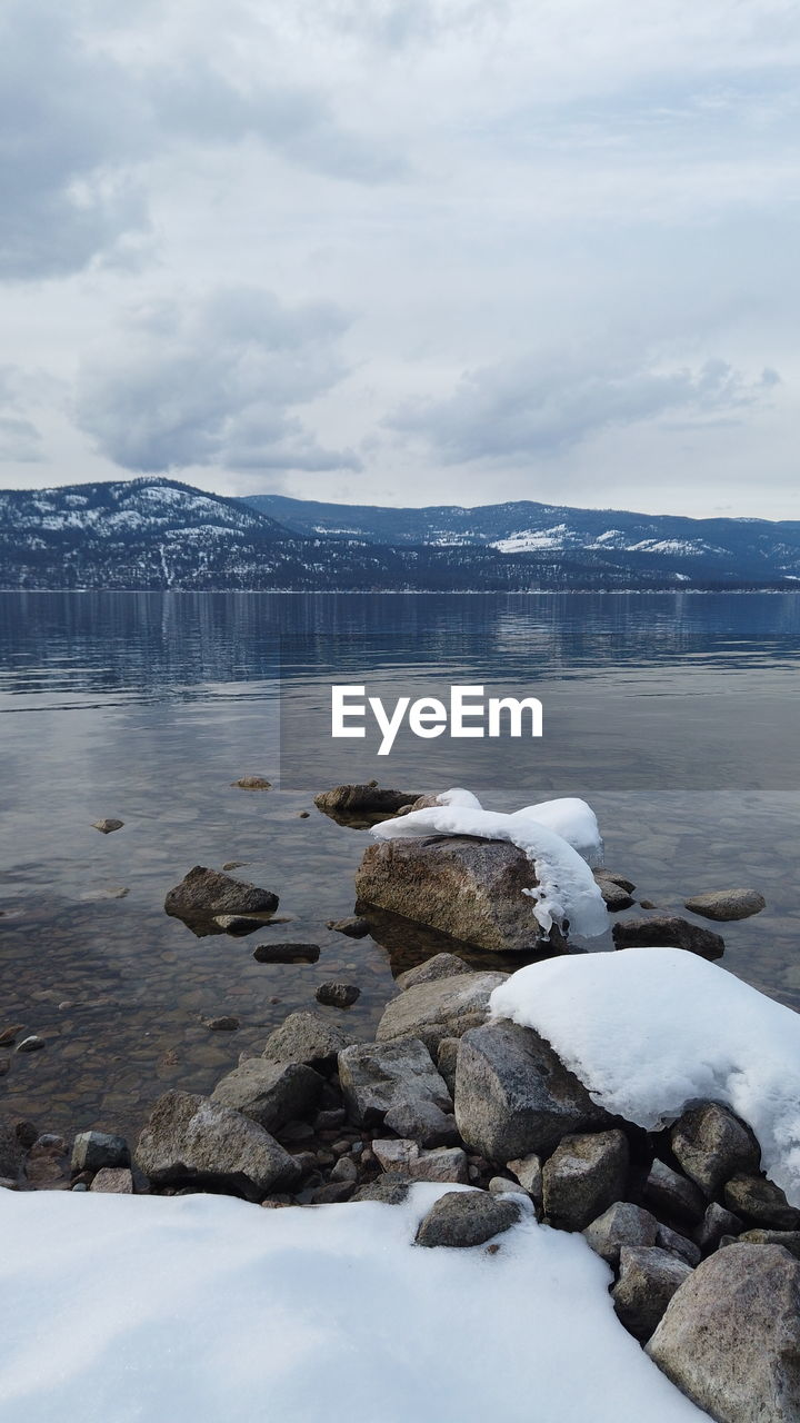 water, cloud - sky, cold temperature, winter, beauty in nature, sky, scenics - nature, rock, solid, tranquil scene, tranquility, nature, snow, sea, rock - object, day, no people, ice, outdoors, snowcapped mountain, iceberg