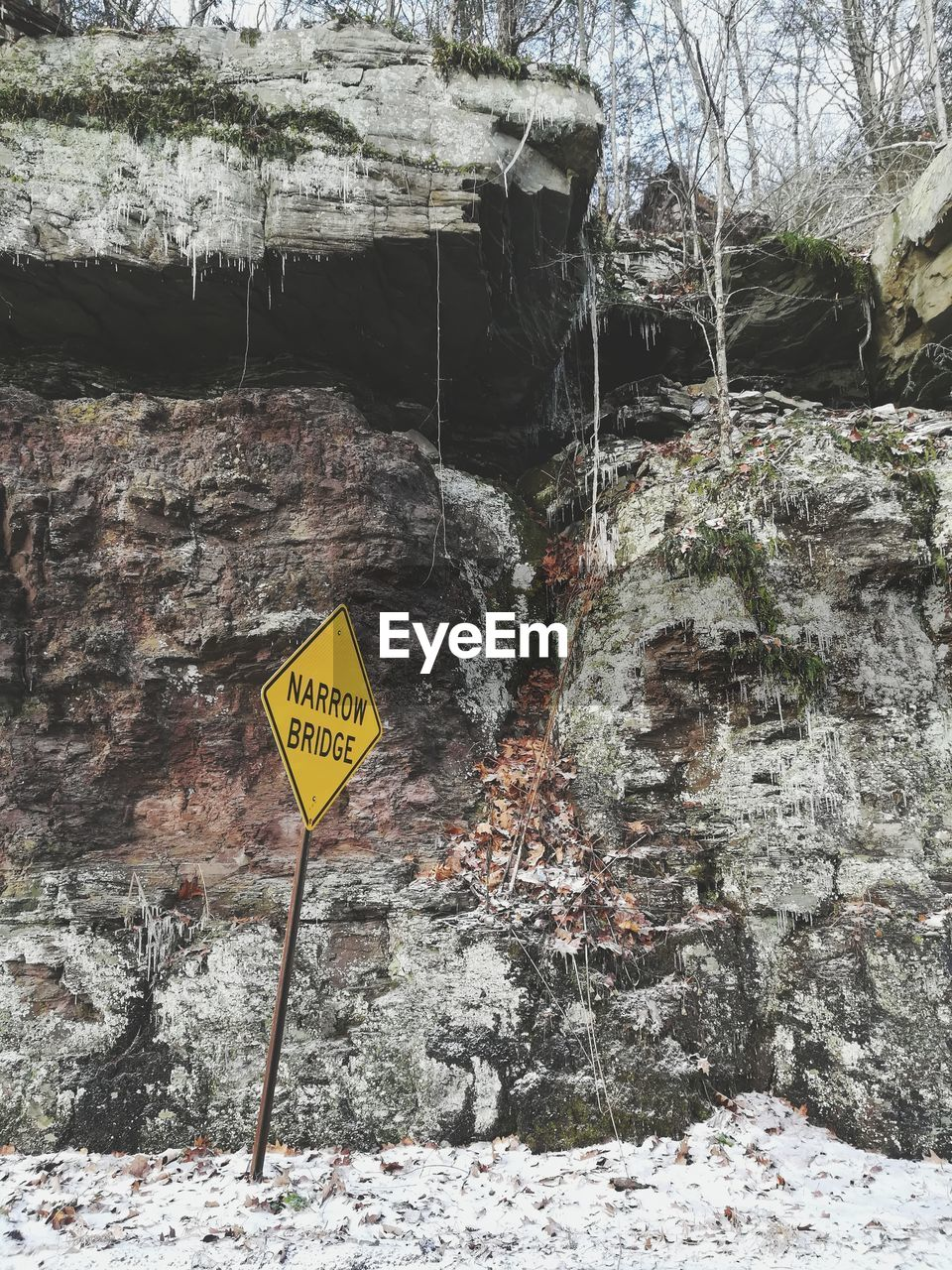 rock - object, warning sign, communication, rock formation, text, danger, no people, outdoors, day, waterfall, nature, water, close-up