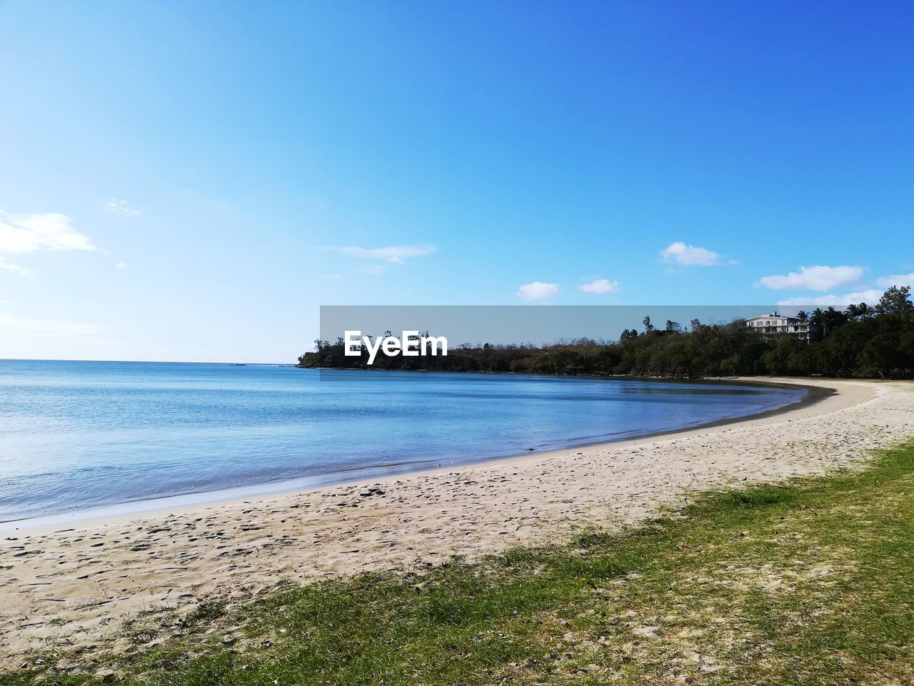 tranquil scene, tranquility, nature, beauty in nature, scenics, water, tree, sky, day, no people, outdoors, blue, beach, sand, landscape, sea