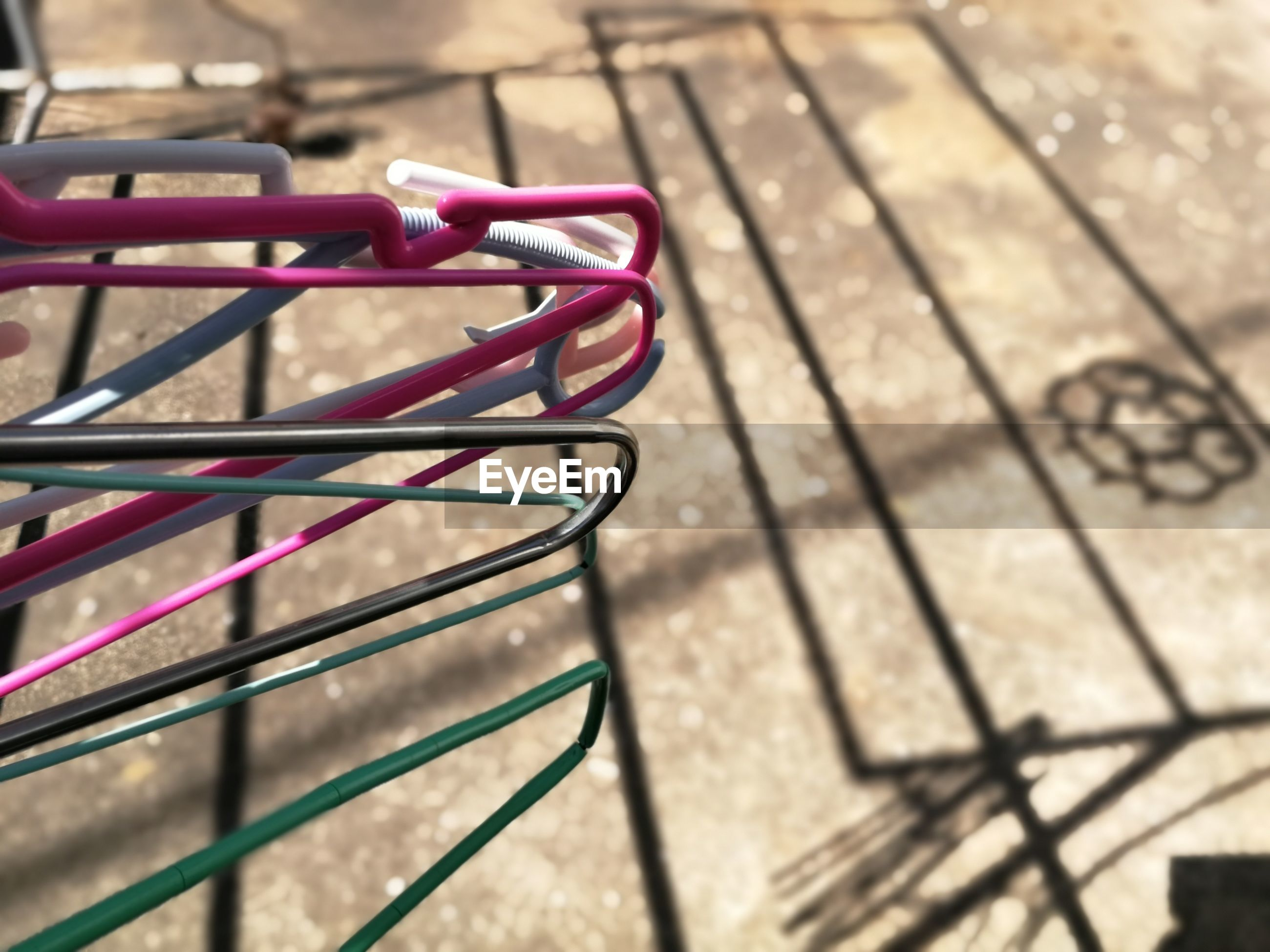 High angle view of clothes hangers, concept about laundry.