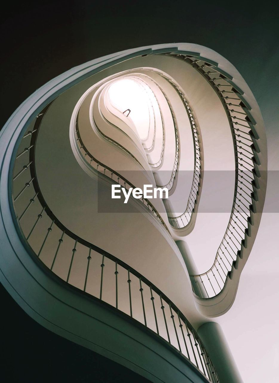 Low angle view of spiral stairs against clear sky