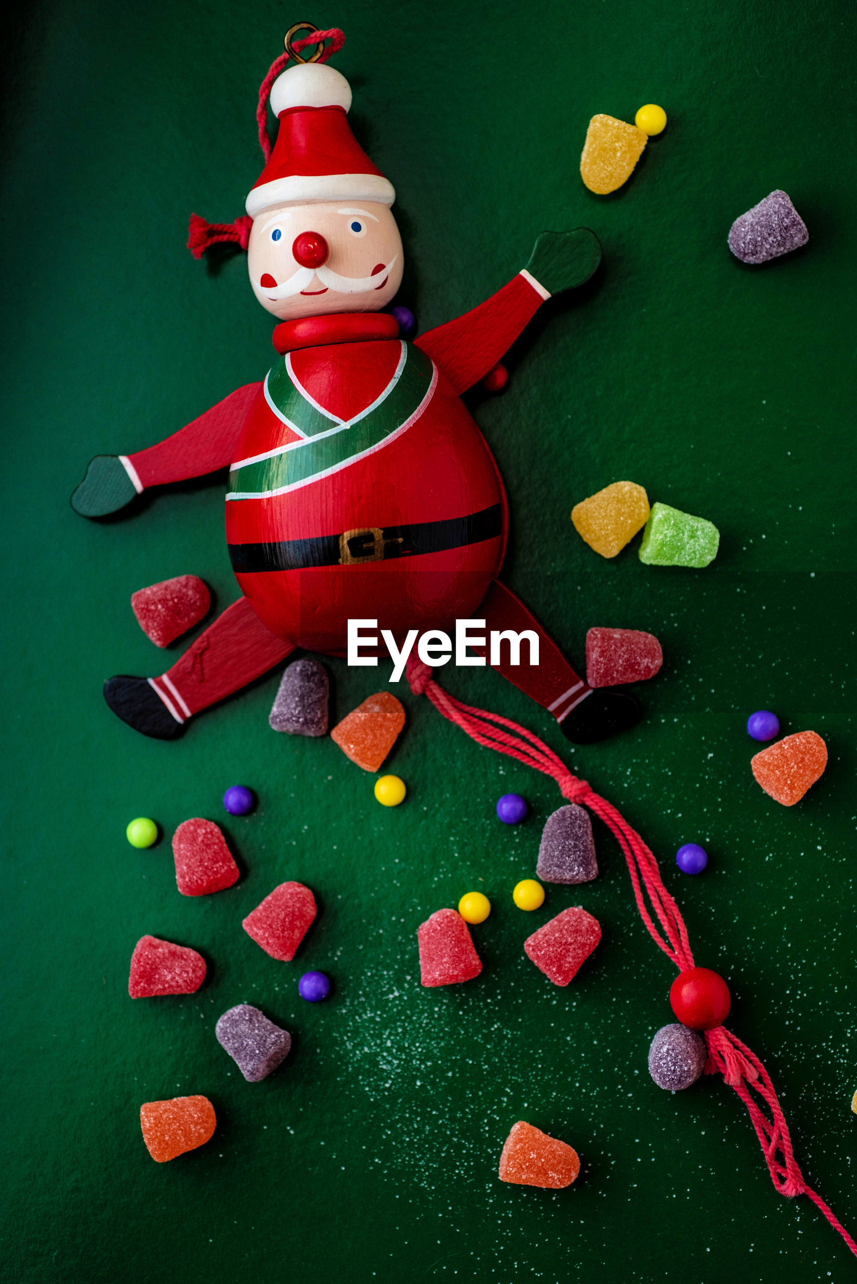 High angle view of red christmas decoration santa claus on green table