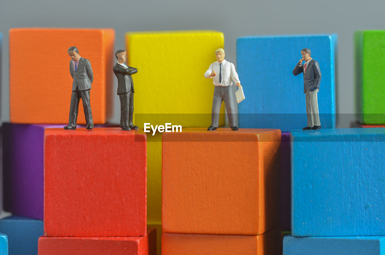 Close-Up Of Figurines On Toy Blocks