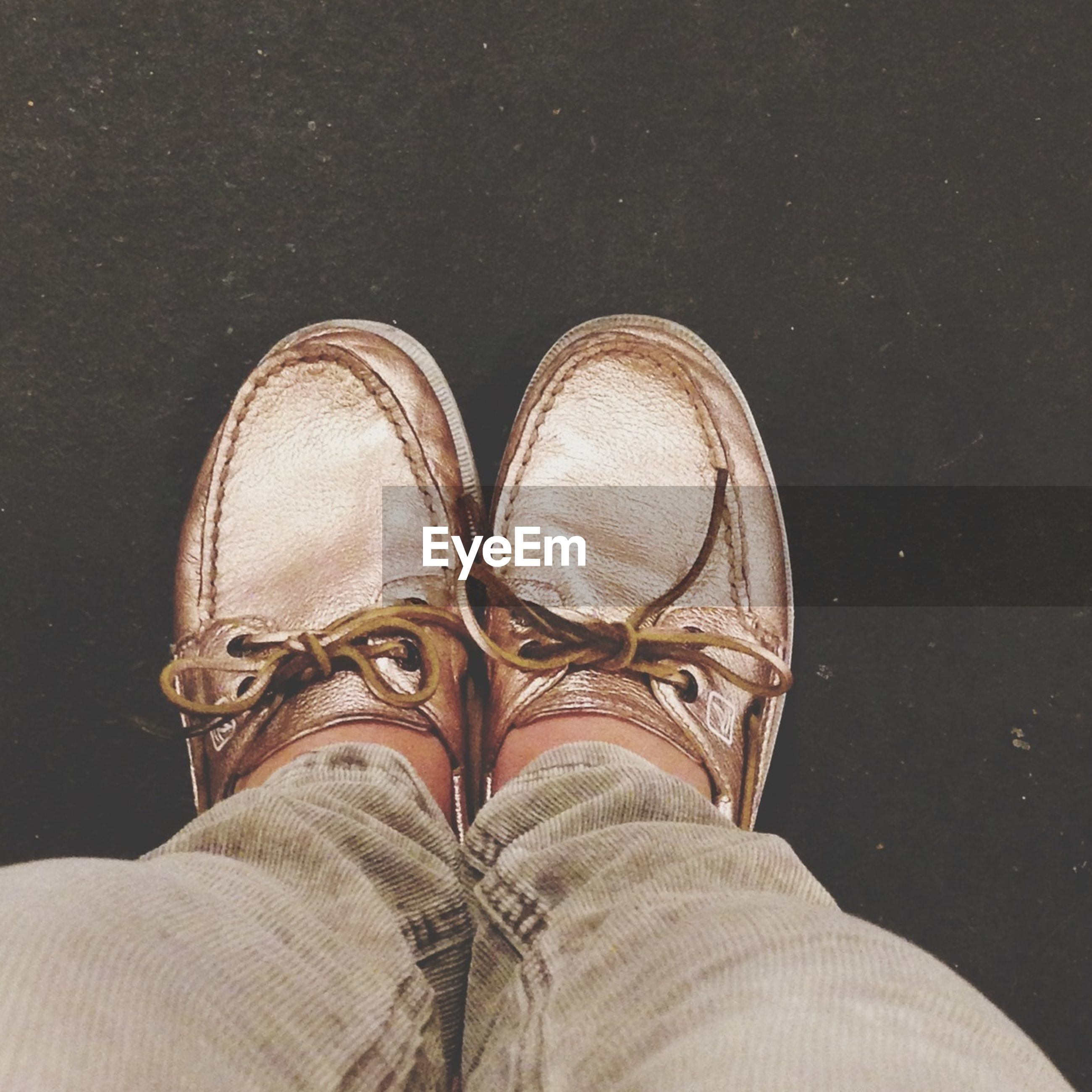 low section, person, shoe, personal perspective, footwear, jeans, human foot, standing, lifestyles, pair, canvas shoe, men, part of, close-up, high angle view, directly above, fashion