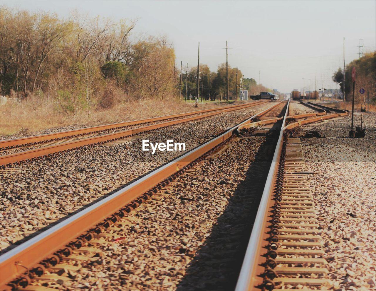 railroad track, rail transportation, transportation, day, railroad tie, railway track, no people, outdoors, travel, the way forward, clear sky, sky, tree, nature