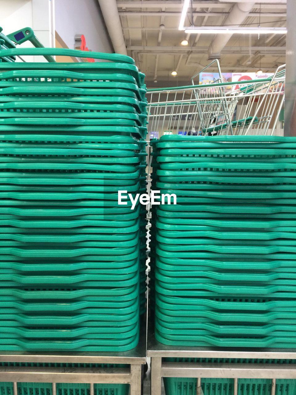 Stack Of Shopping Baskets At Supermarket