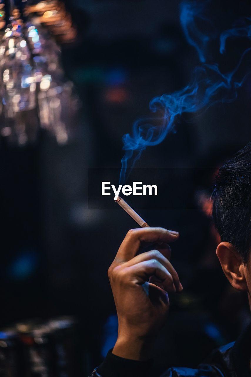 Cropped Image Of Man Smoking Cigarette
