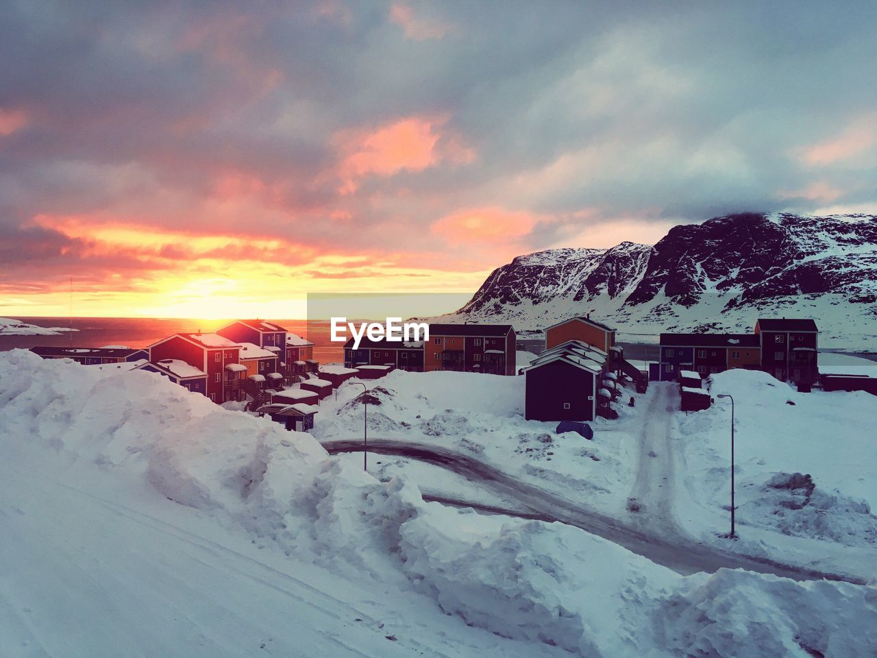snow, winter, cold temperature, weather, sky, cloud - sky, nature, sunset, scenics, mountain, outdoors, no people, tranquil scene, beauty in nature, tranquility, frozen, transportation, built structure, mountain range, building exterior, landscape, snowdrift, day, architecture