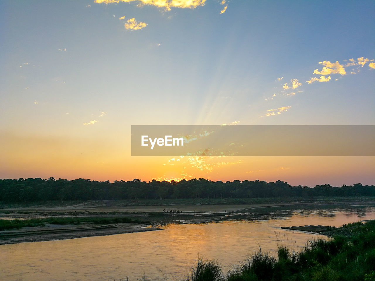 sunset, water, nature, beauty in nature, scenics, tranquil scene, orange color, reflection, sky, river, tranquility, tree, sun, no people, outdoors, sunlight, landscape, day