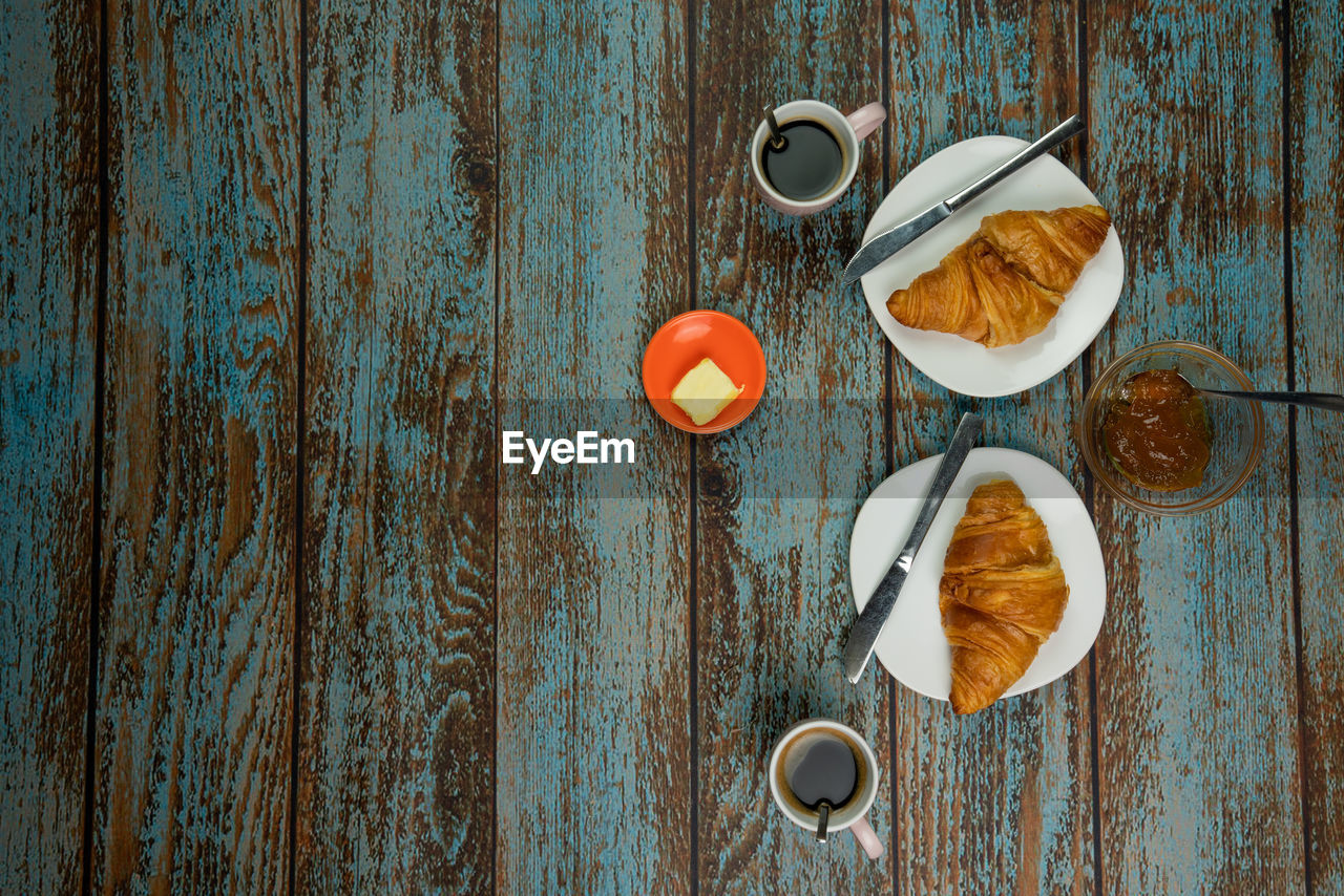 food and drink, wood - material, food, table, still life, freshness, no people, eating utensil, kitchen utensil, directly above, indoors, spoon, healthy eating, wellbeing, high angle view, cup, egg, close-up, day, mug, breakfast, snack