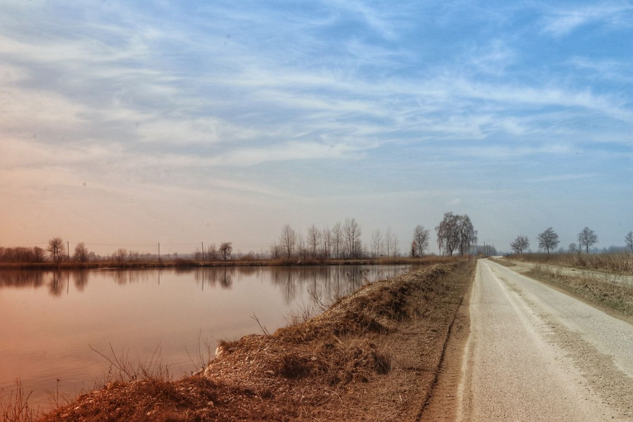 the way forward, nature, sky, tranquil scene, outdoors, no people, transportation, beauty in nature, scenics, tree, road, water, day