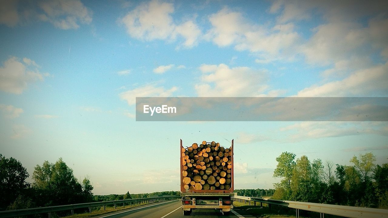 stack, tree, sky, transportation, no people, cloud - sky, day, large group of objects, nature, outdoors