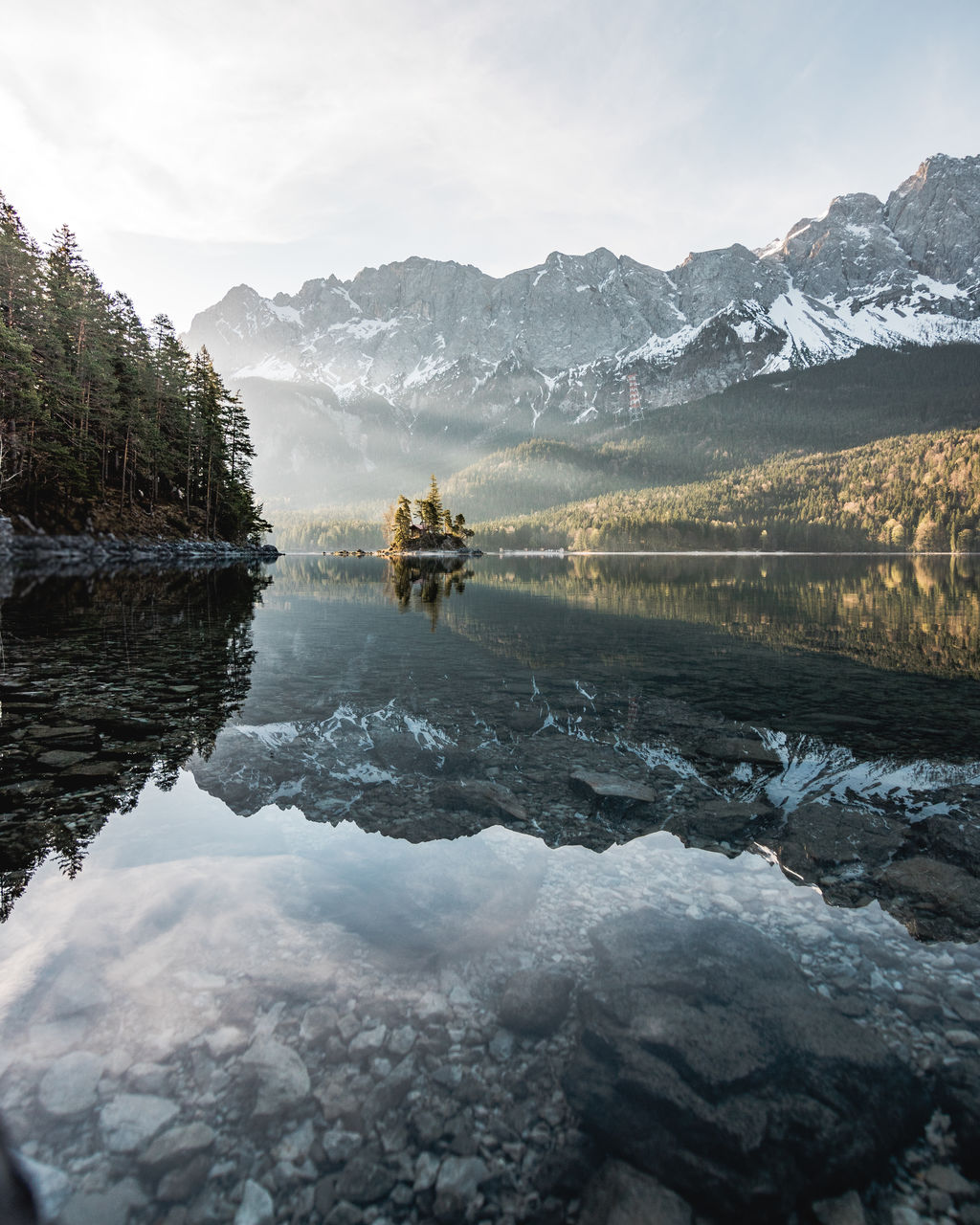Reflection Of Mountains On Calm Lake