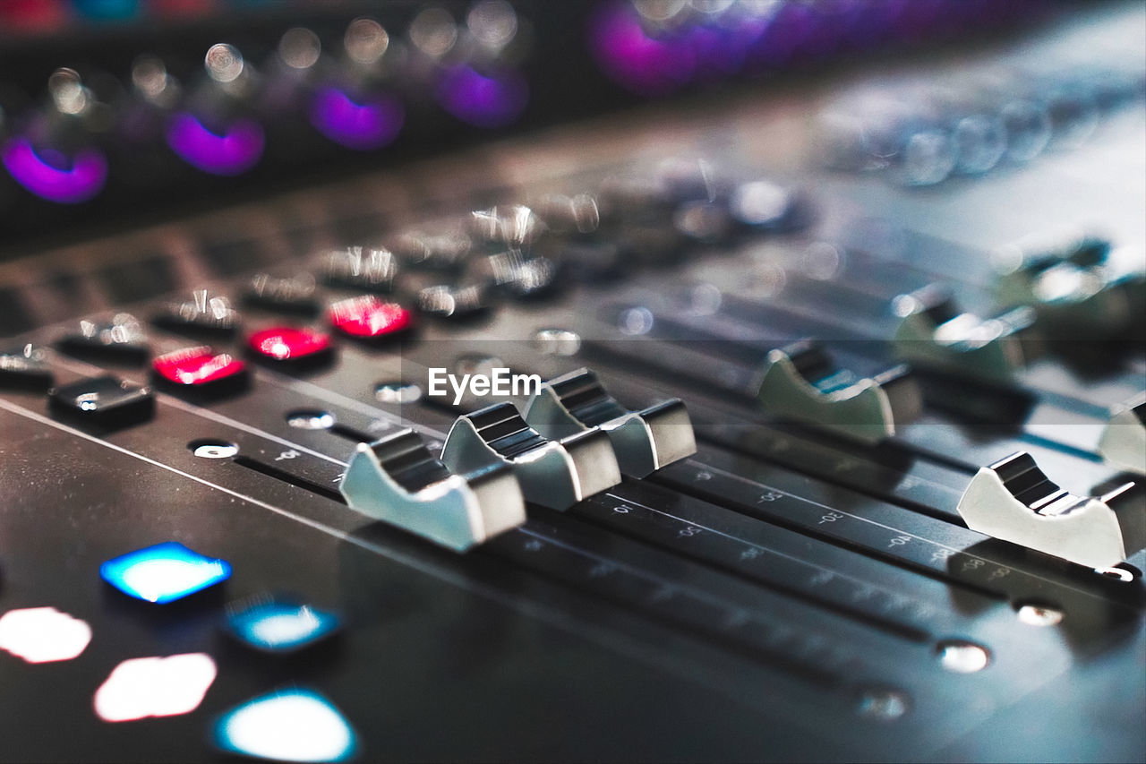 music, technology, audio equipment, control, sound mixer, sound recording equipment, selective focus, indoors, close-up, arts culture and entertainment, control panel, illuminated, no people, recording studio, studio, high angle view, keyboard, computer, knob, equipment, push button, mixing, electrical equipment