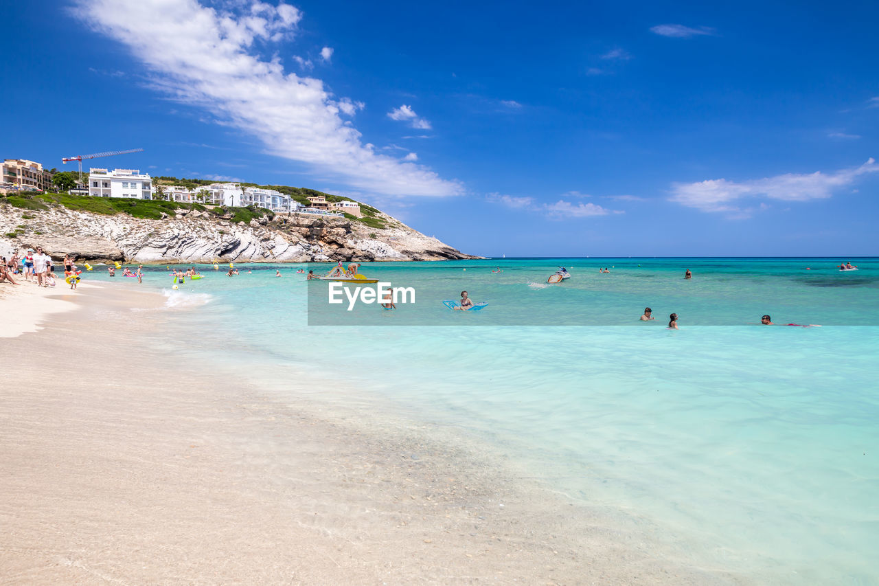 water, sea, sky, beach, land, beauty in nature, cloud - sky, scenics - nature, nature, blue, day, horizon over water, vacations, trip, holiday, tranquility, tranquil scene, group of people, incidental people, outdoors, turquoise colored