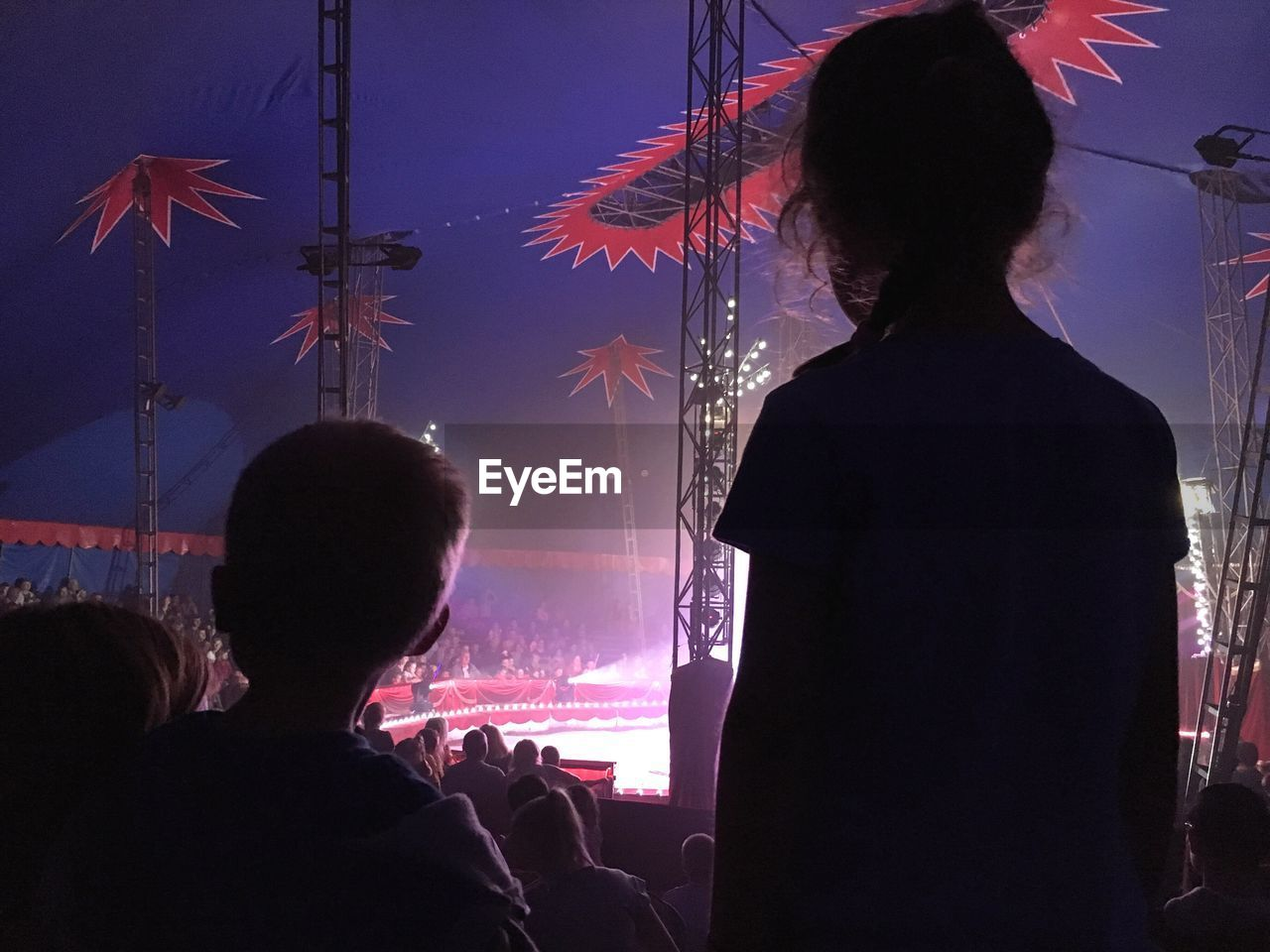 Silhouette People Enjoying Show During Festival At Amusement Park