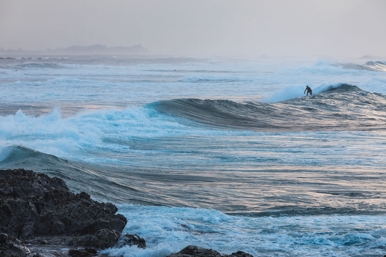 sea, water, wave, beauty in nature, motion, scenics - nature, horizon over water, sky, nature, day, land, rock, horizon, beach, waterfront, aquatic sport, sport, surfing, outdoors, power in nature, flowing water