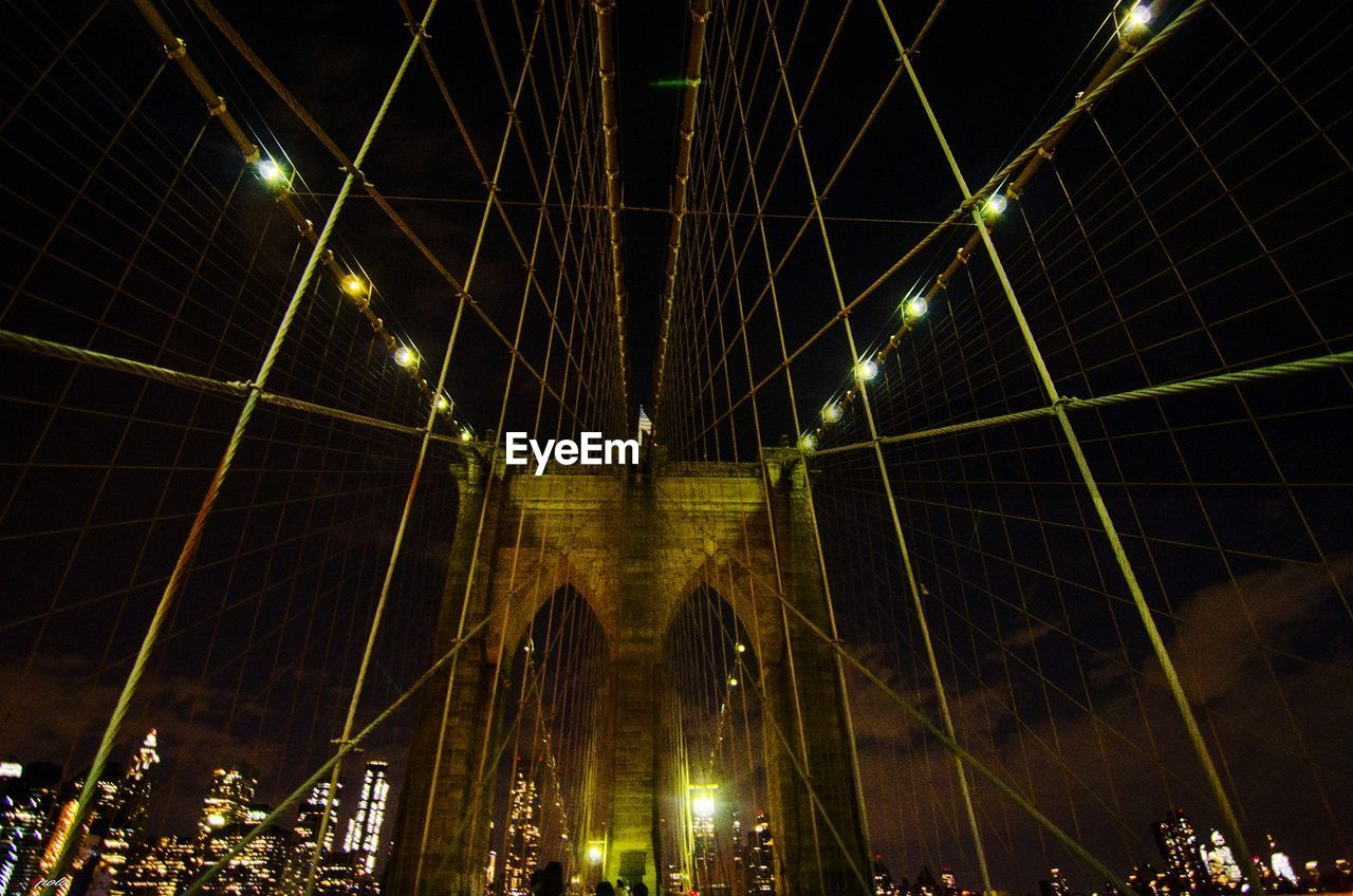 built structure, illuminated, architecture, night, engineering, bridge, connection, bridge - man made structure, low angle view, transportation, travel destinations, lighting equipment, city, nature, building exterior, suspension bridge, tourism, outdoors, light
