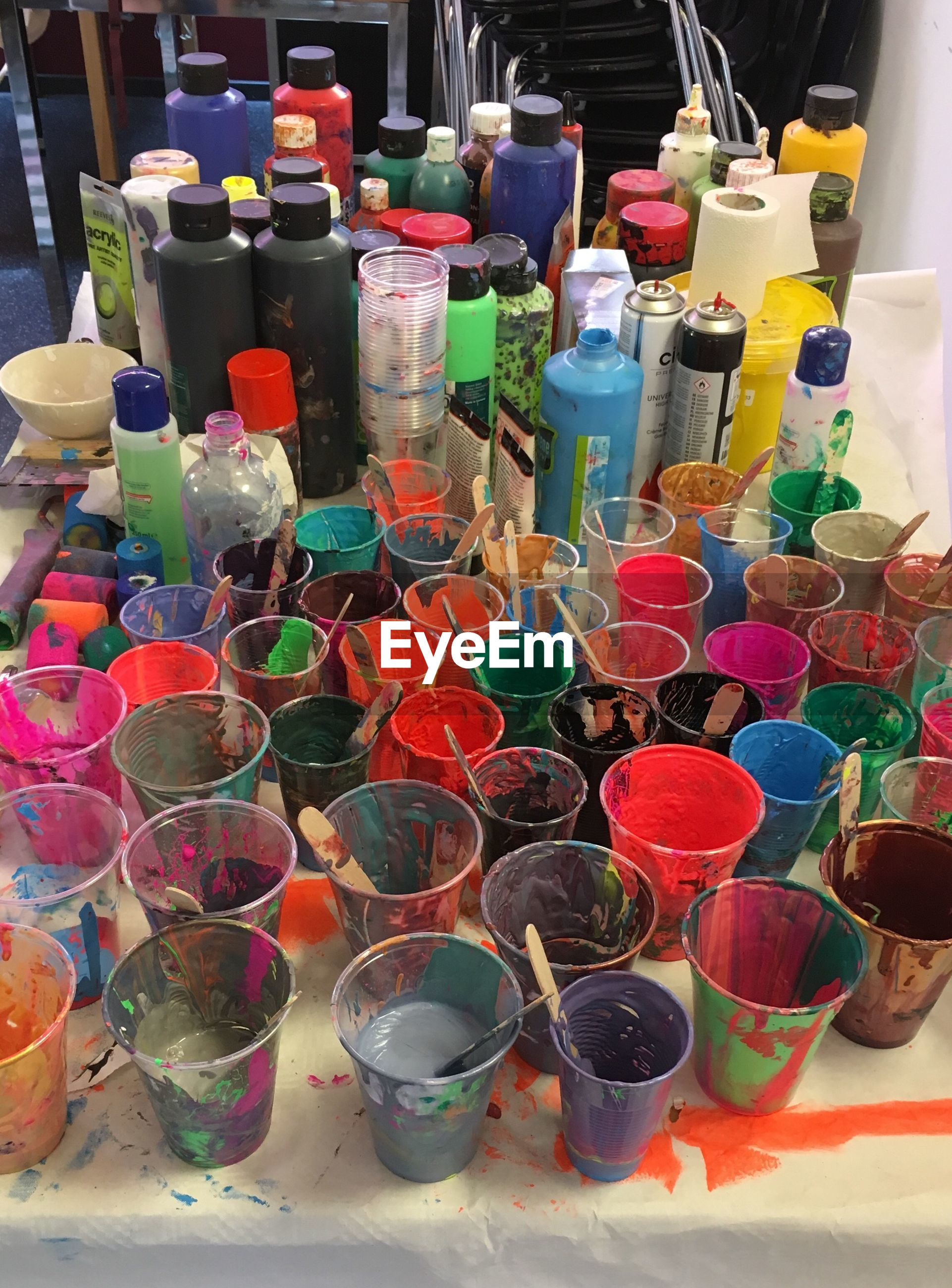 High angle view of colorful paints on table