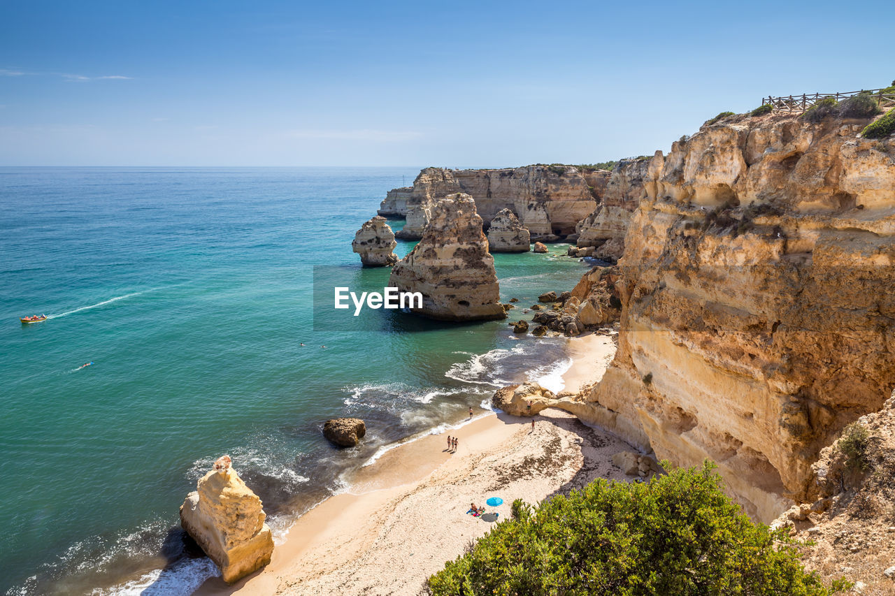 sea, water, sky, rock, rock - object, beauty in nature, scenics - nature, land, solid, rock formation, beach, nature, tranquil scene, horizon over water, horizon, tranquility, day, blue, idyllic, no people, outdoors, stack rock