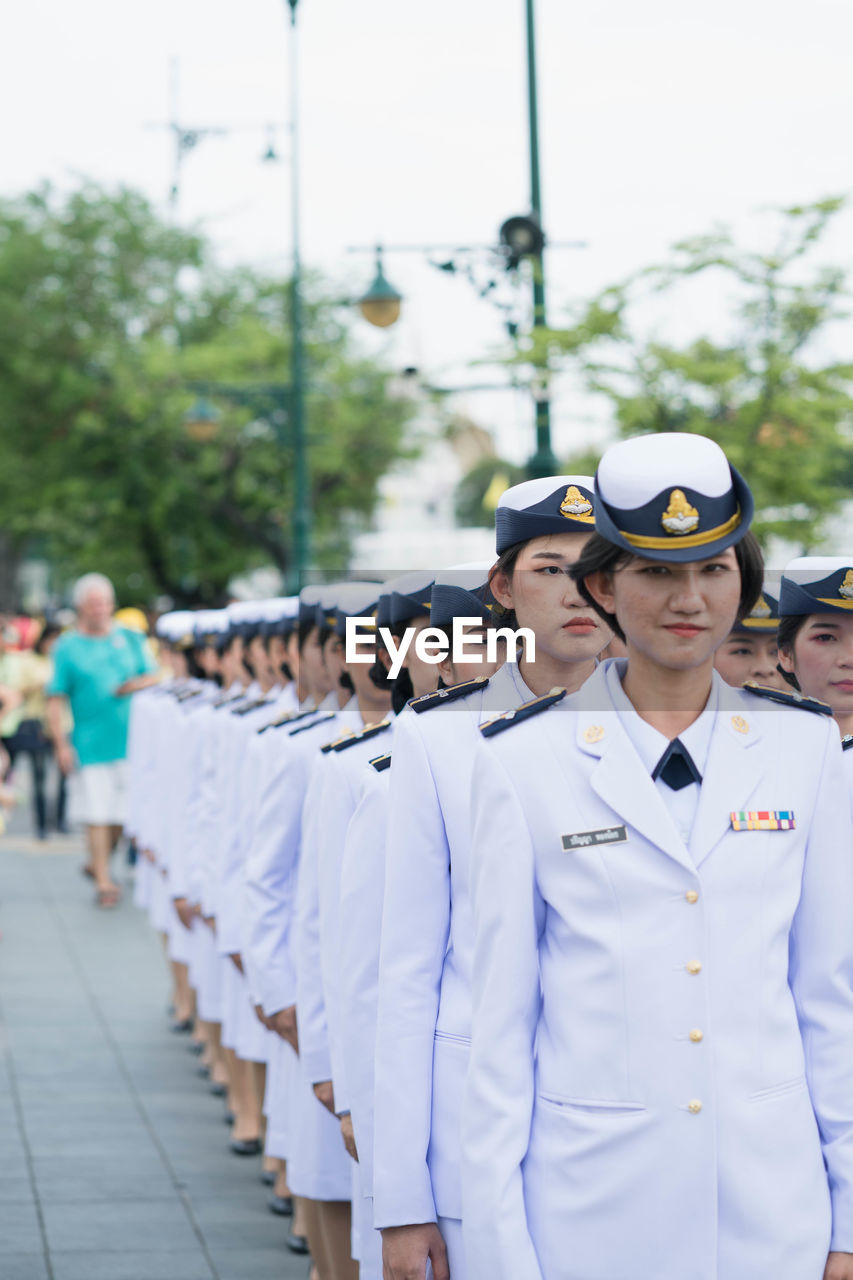 real people, clothing, uniform, group of people, men, day, people, military, military uniform, government, armed forces, army soldier, focus on foreground, outdoors, standing, in a row, celebration, incidental people, emotion, sailor, officer