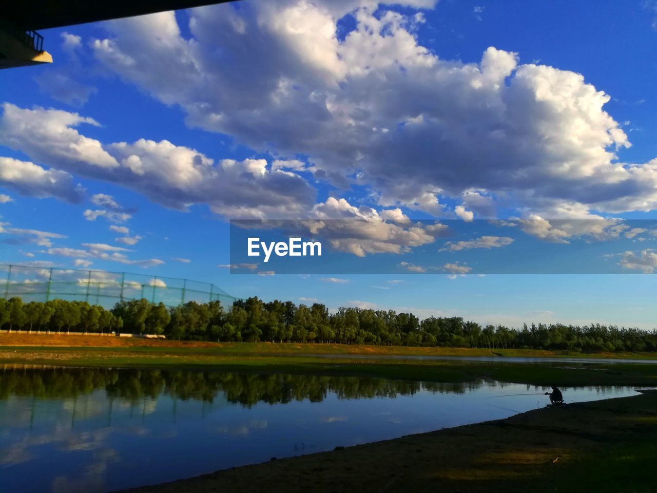 cloud - sky, sky, water, reflection, tranquility, nature, beauty in nature, lake, tranquil scene, tree, plant, scenics - nature, landscape, outdoors, land, environment, day, idyllic