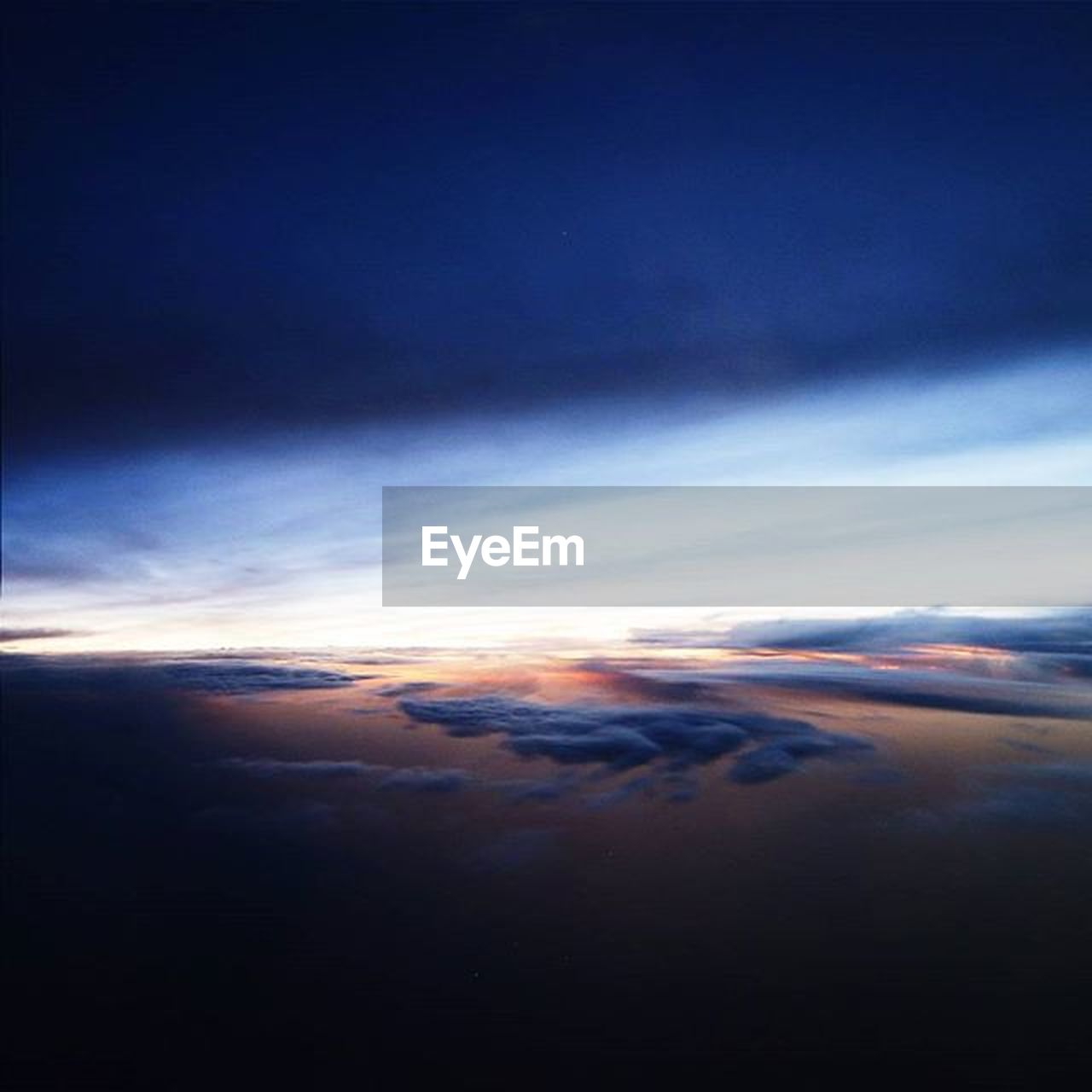 cloud - sky, sky, nature, tranquil scene, dramatic sky, scenics, tranquility, cloudscape, beauty in nature, sunset, sky only, no people, backgrounds, blue, space, ethereal, outdoors, awe, astronomy, planet earth, day, satellite view