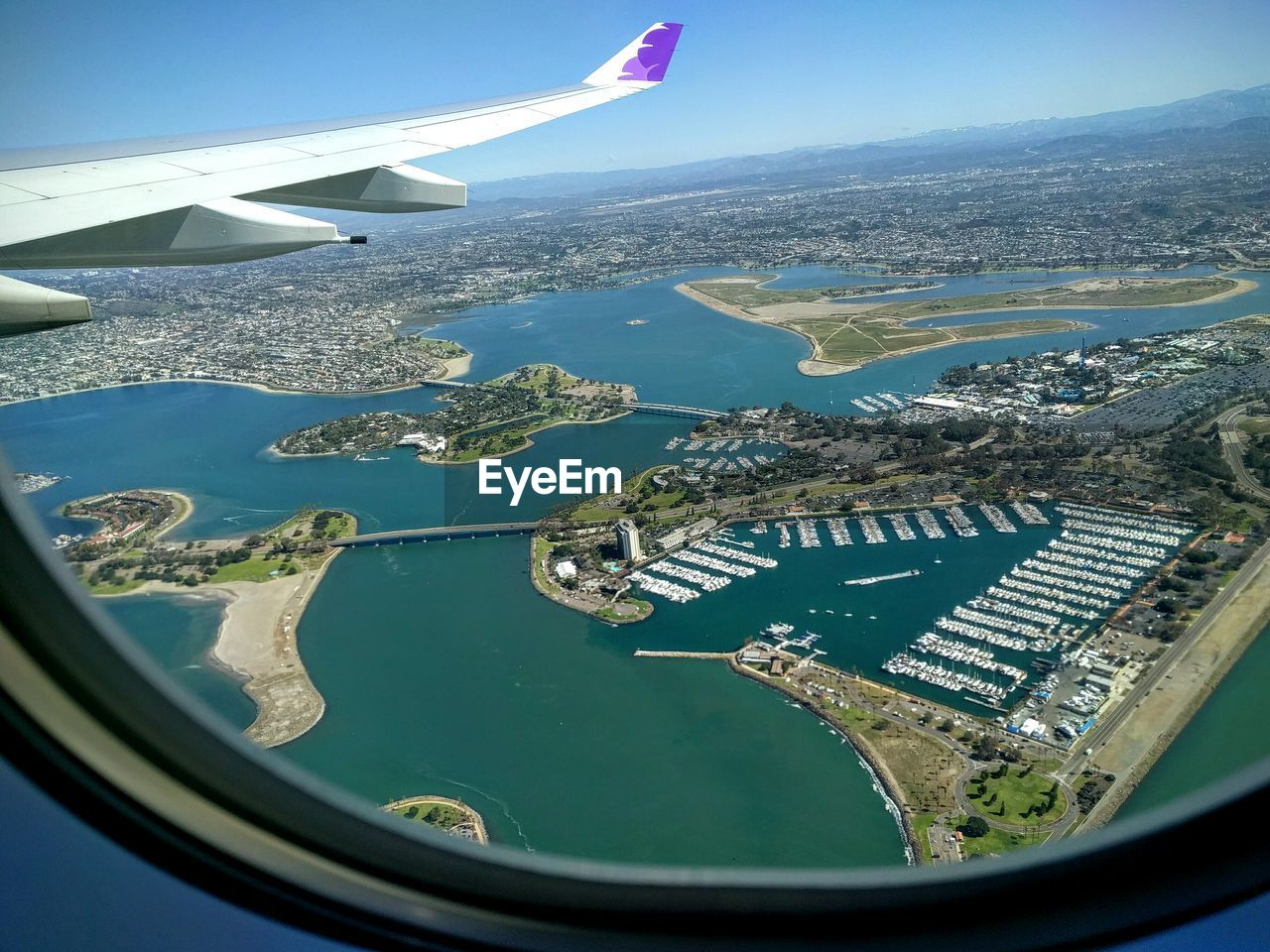 aerial view, transportation, water, sea, flying, airplane, no people, travel, landscape, architecture, day, air vehicle, city, outdoors, nature, cityscape, airplane wing, sky
