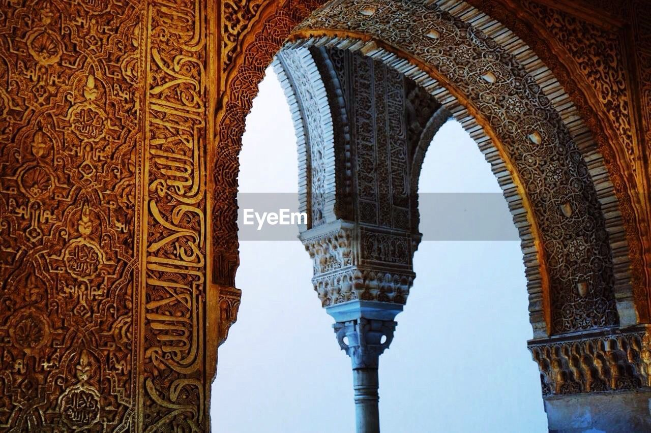 architecture, built structure, arch, history, the past, no people, building exterior, travel destinations, day, architectural column, building, craft, tourism, travel, religion, carving - craft product, sky, pattern, low angle view, ornate, ceiling