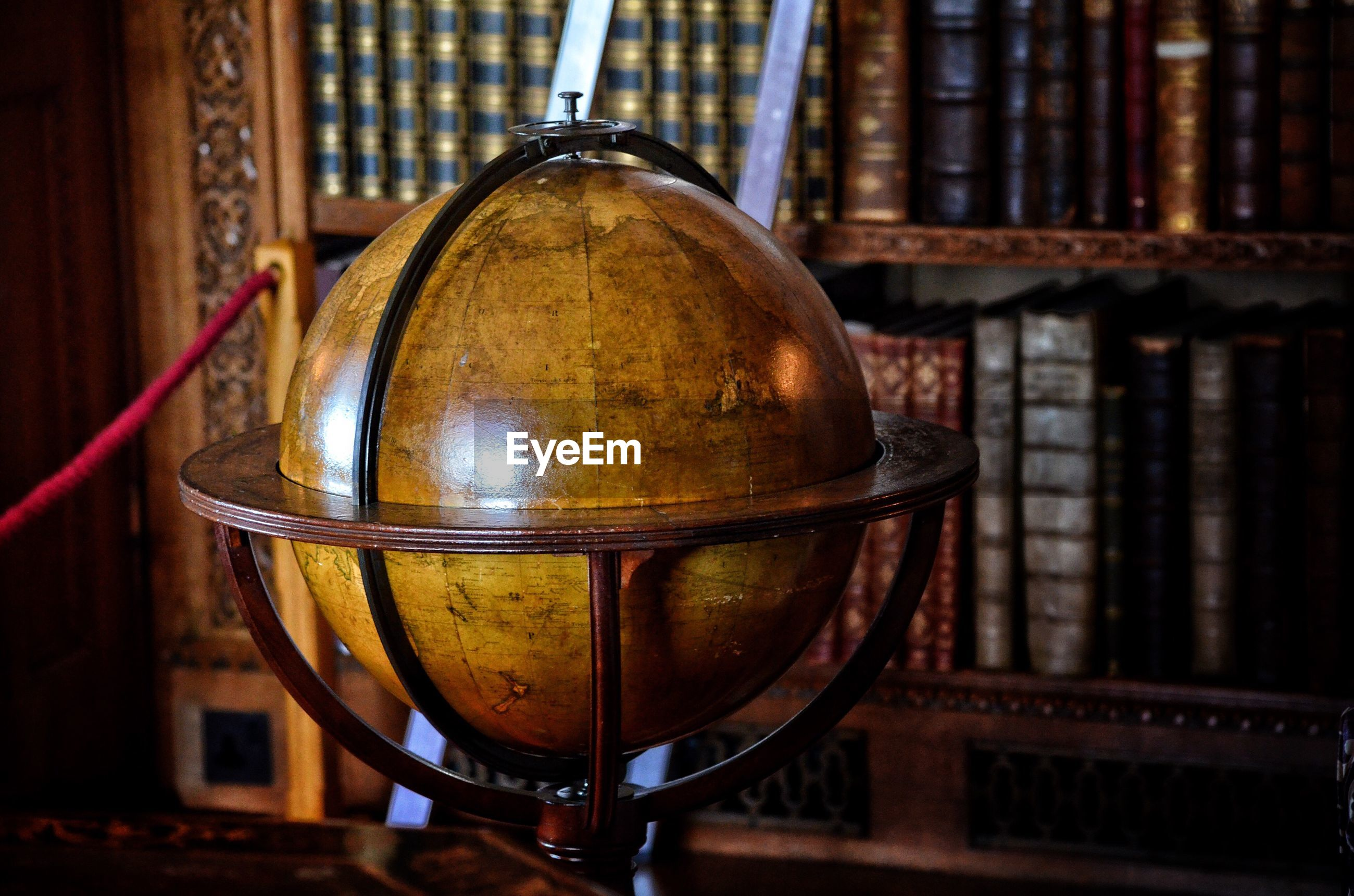 Globe against bookshelf
