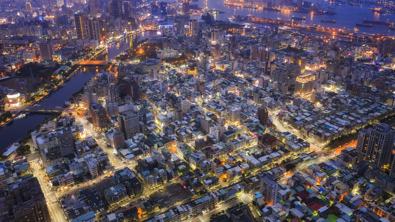 High Angle View Of Illuminated Street And Buildings In City At Night