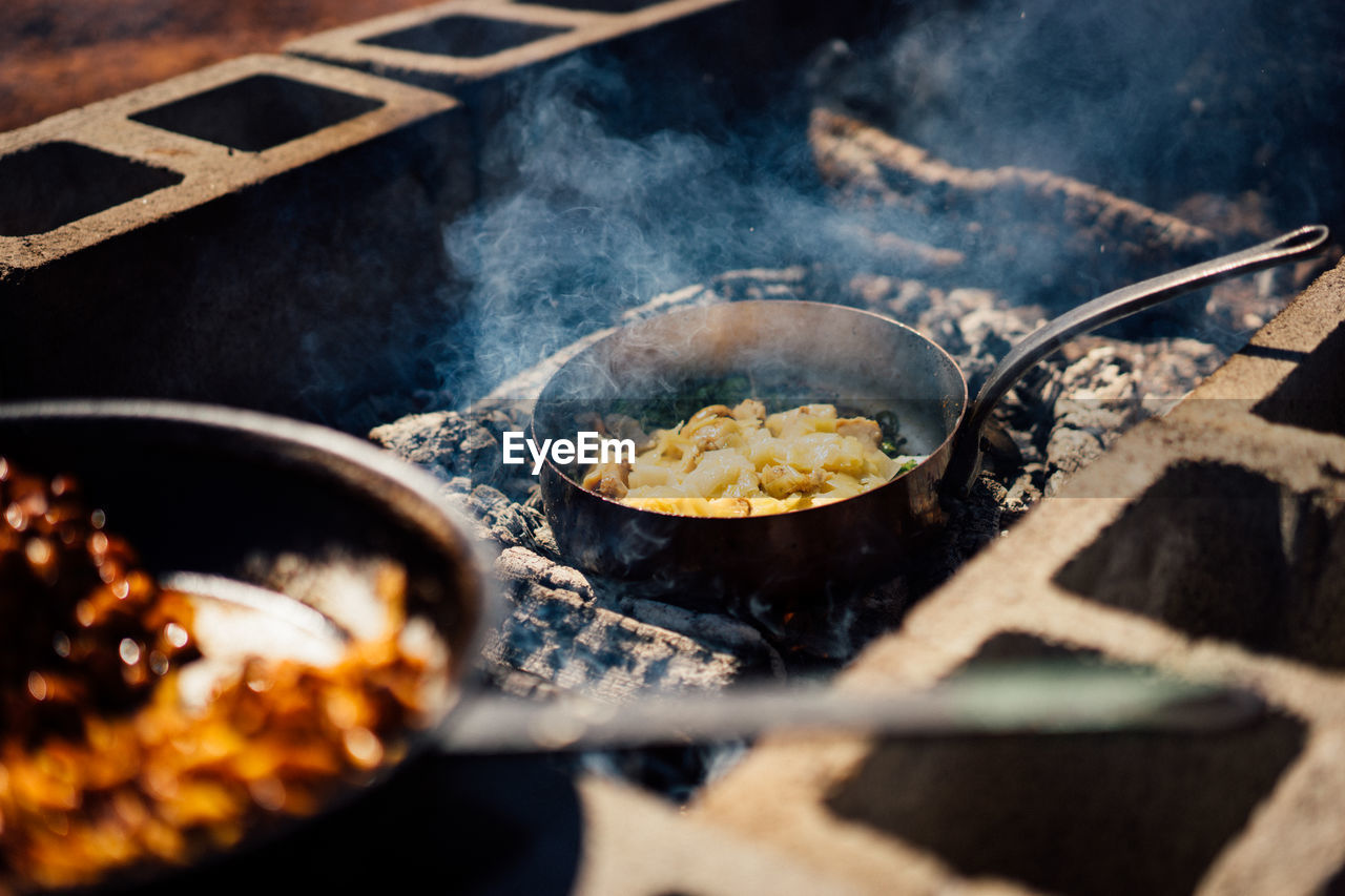 food and drink, food, heat - temperature, freshness, kitchen utensil, preparation, burning, smoke - physical structure, cooking pan, preparing food, frying pan, meat, close-up, selective focus, pan, no people, household equipment, steam, fire, wellbeing