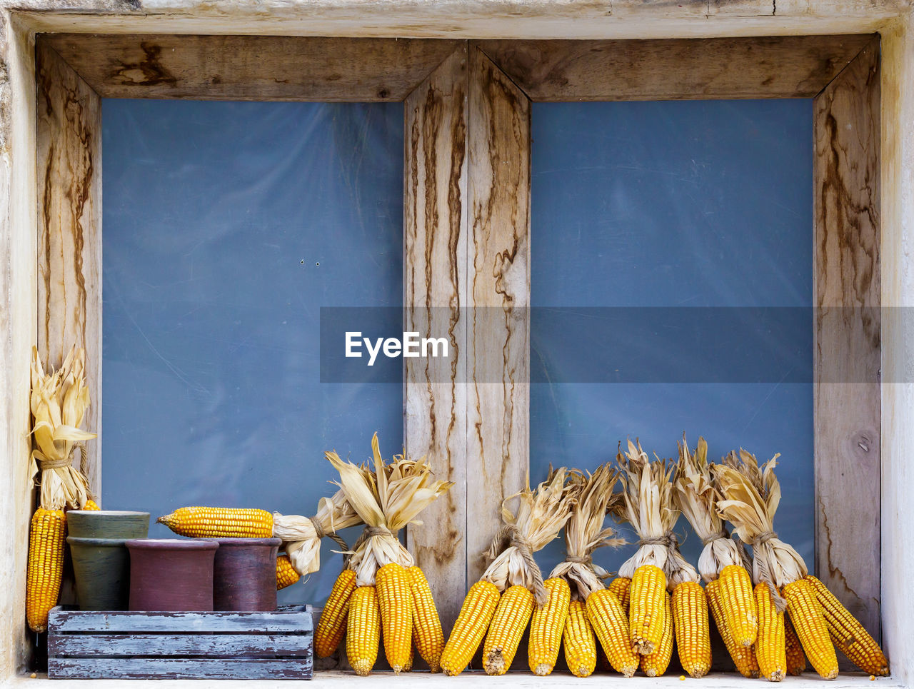 food and drink, wood - material, healthy eating, wellbeing, food, no people, vegetable, freshness, indoors, corn, day, architecture, yellow, built structure, still life, blue, window, fruit, close-up, sweetcorn