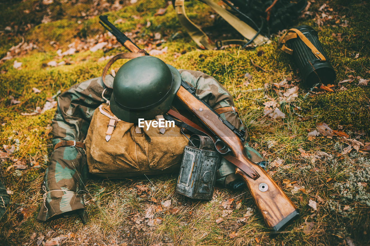 military, gun, armed forces, weapon, army soldier, rifle, government, land, field, day, army, camouflage clothing, military uniform, one person, aiming, nature, real people, uniform, clothing, outdoors, machine gun, aggression